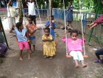 Pikinini (children) playing on some swings
