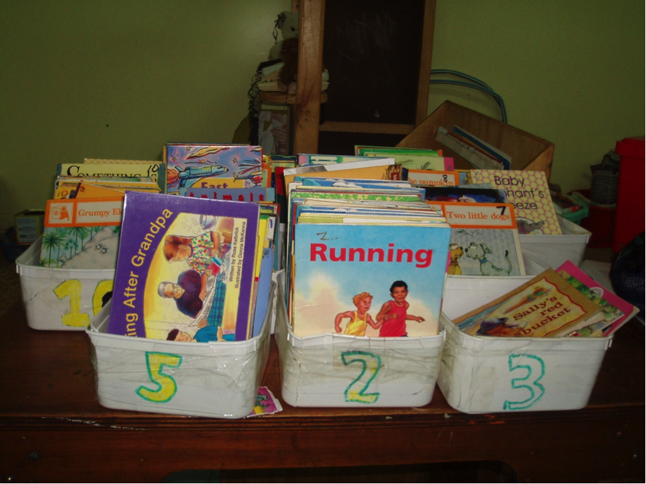 Books sorted into three boxes labelled 5, 2 and 3