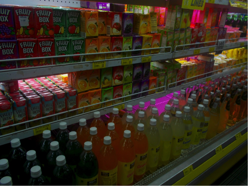 A supermarket fridge filled with cold drinks