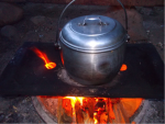 A cooking pot on an open fire