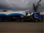 A fuel tanker parked on the side of the road