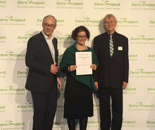 Elena Jenkin from Deakin University holds up the Zero award. On her right side is Martin Essl, founder of the Essl Foundation and on her left is Jakob Von Uexkull, founder of the World Future Council